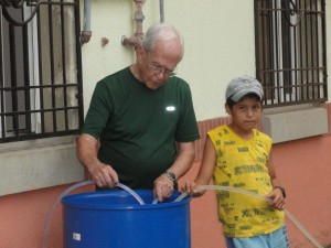 Papi Don and Cristian manning the water tanks